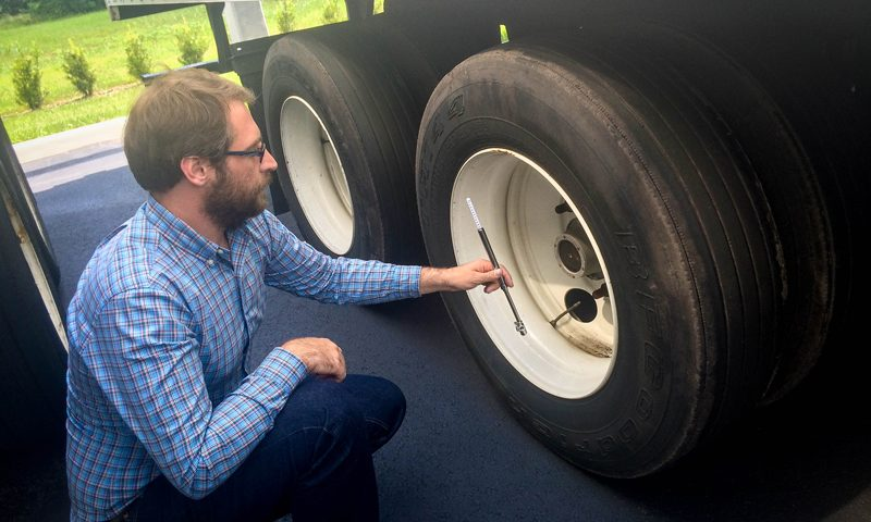 Status Trucks Tire Safety - Inspecting tire pressure