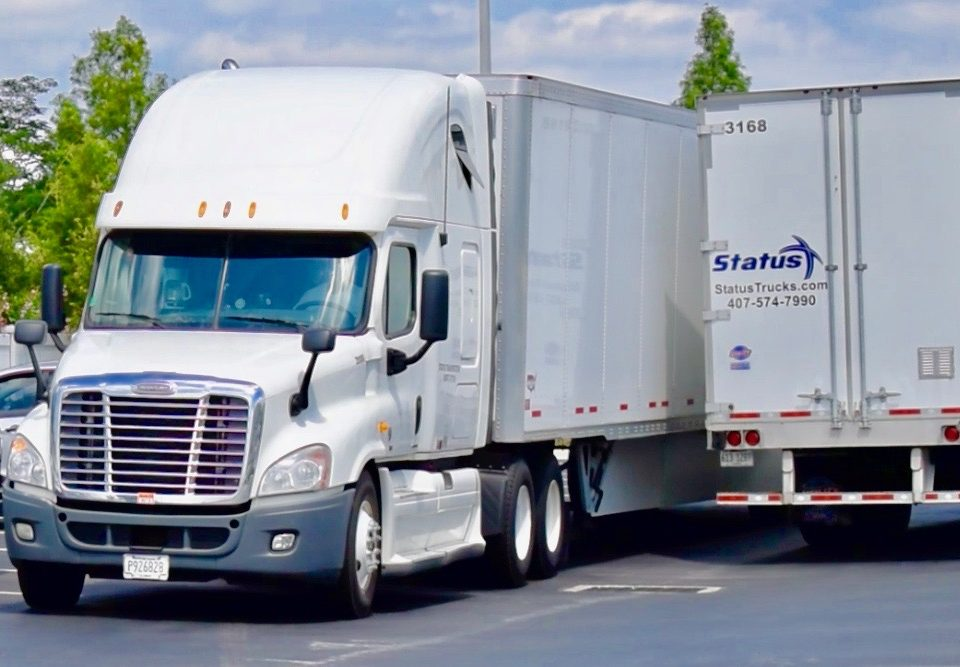 Status Transportation Owner Operators in lot