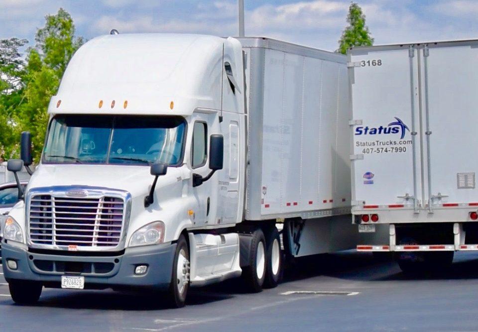 Status Transportation Owner Operators in lot