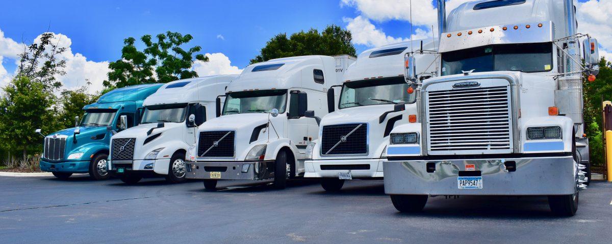 Trucks in Status Transportation Lot
