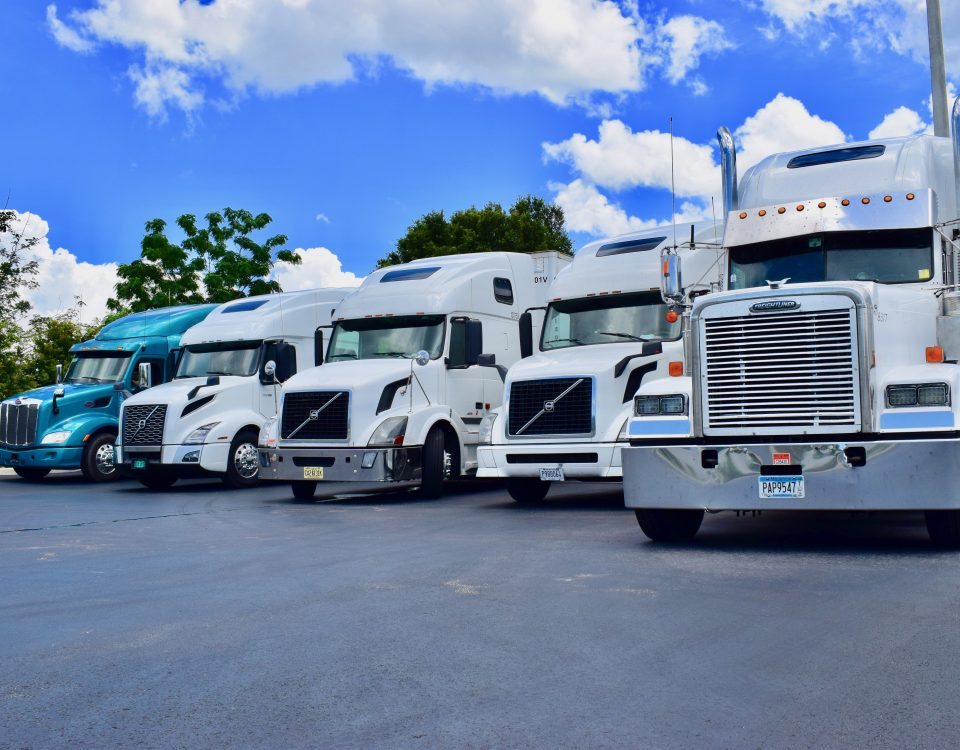 Trucks in Status Transportation Lot