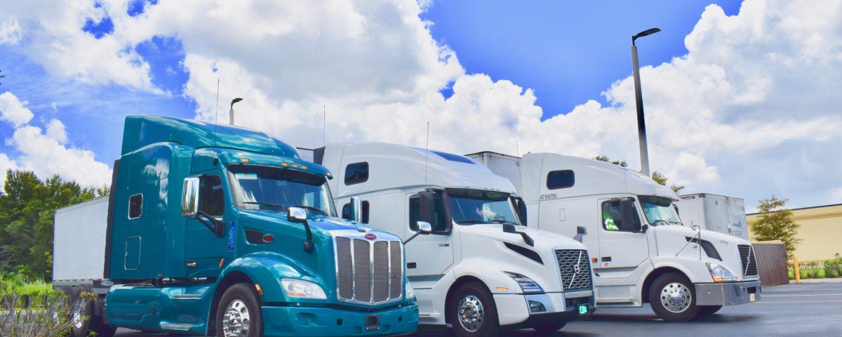 Three Owner Operators Parked at Status Transportation Winter Garden, FL location.