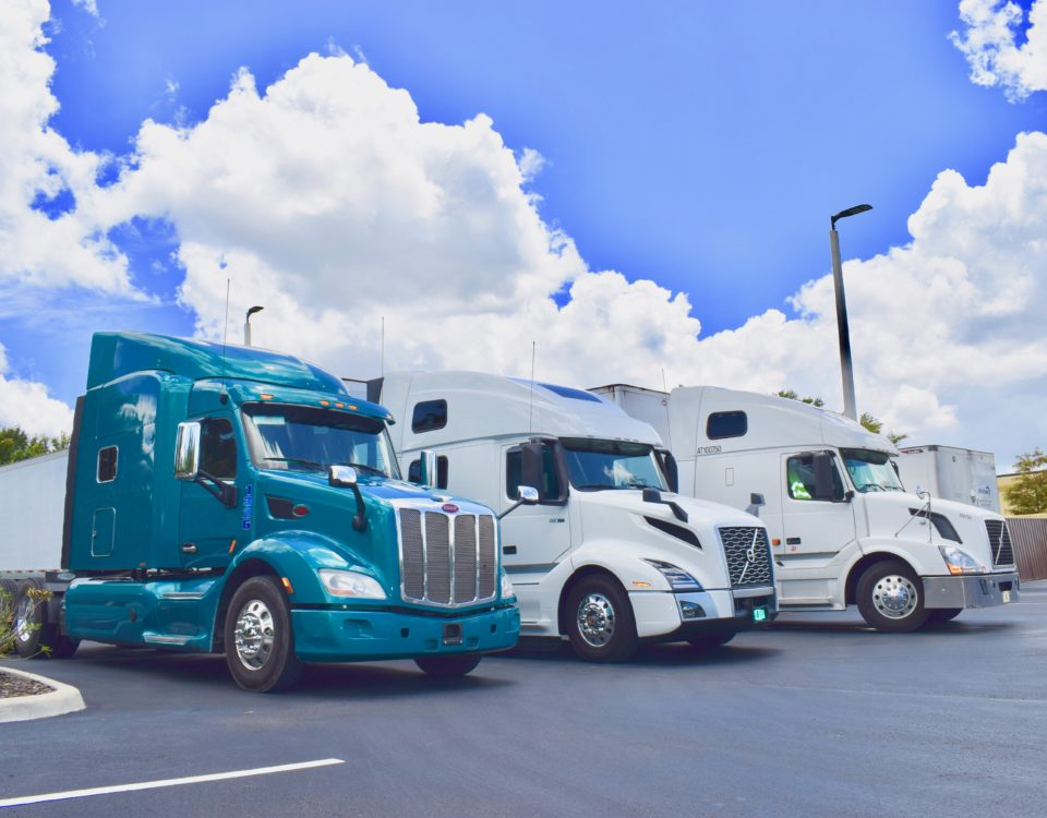 Three Owner Operators Parked at Status Transportation Winter Garden, FL location.